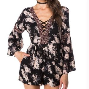 Angie • Bell Sleeve Criss Cross Floral Romper